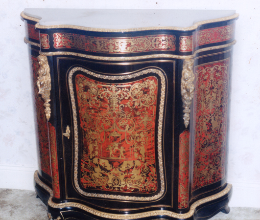Photo of restored Boule cabinet with intricate pattern