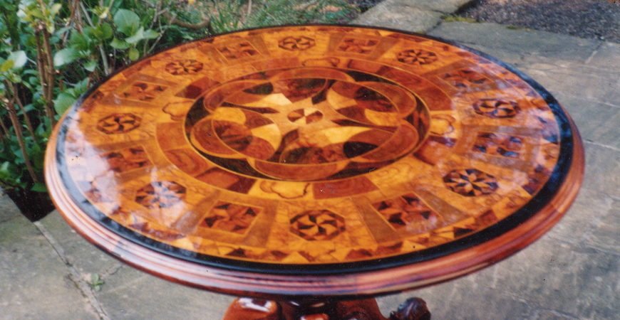 Photo of restored table with intricate marquetry